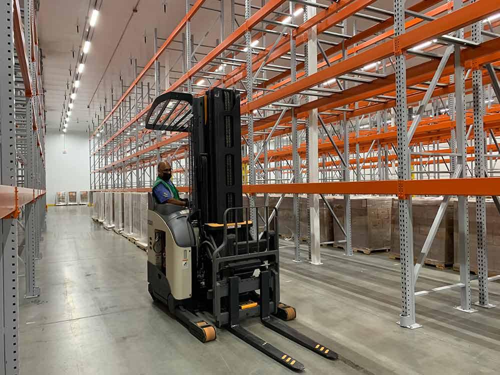 Forklift operator inside distribution facility