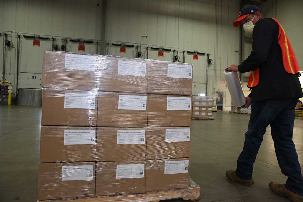 Preparing ancillary supply kits for distribution.