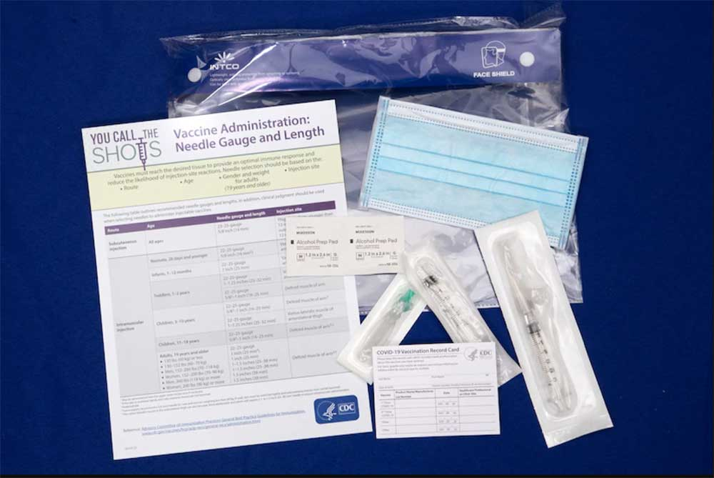 Contents contained inside a COVID-19 vaccine ancillary supply kit.