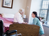 Long term care nurse with elderly female resident