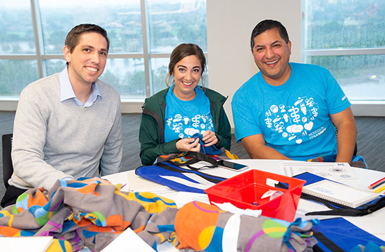 Employees volunteer to create comfort items for cancer patients. Just by signing up, they also earn grants for their local cancer care nonprofit partners.